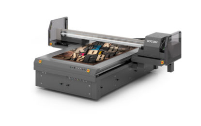 New RICOH Pro T7210 flatbed printer to be unpacked at SGIA Expo 2017